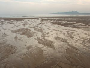 Dunstanburgh Castle, Northumberland - the decapitated spectre of Thomas Plantagenet has been sighted here.