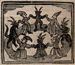V0025811ETR Witchcraft: witches and devils dancing in a circle. Woodcut,