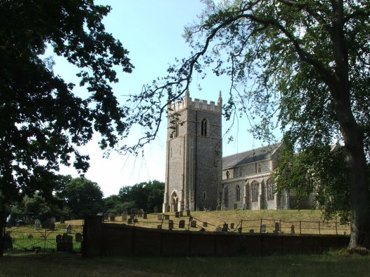St Withburga Church, half a mile from the hall.  Situated on the site of the medieval village of Holkham, the church dates from the 13th Century.  It has the flint facings typical of Norfolk churches. Image by Lenora.