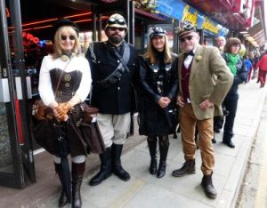 A group of intrepid steam punks outside the penny arcade.