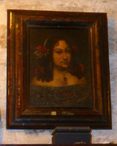 It is said that this is a portrait of a witch who both curses and protects Chillingham Castle.