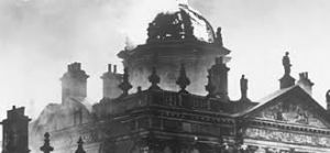 Detail of stately home on fire c1940s. Image source unknown.