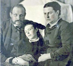 Deceased young girl, with her parents. Source BBC.