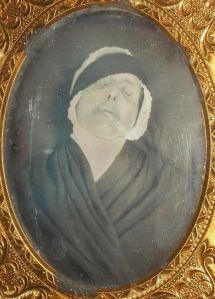 Tintype post mortem photograph. Source unknown.